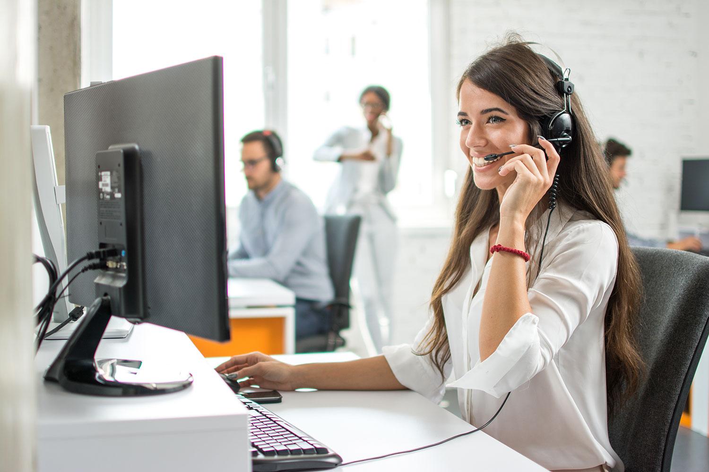 Happy-employees-on-phone-1147848674